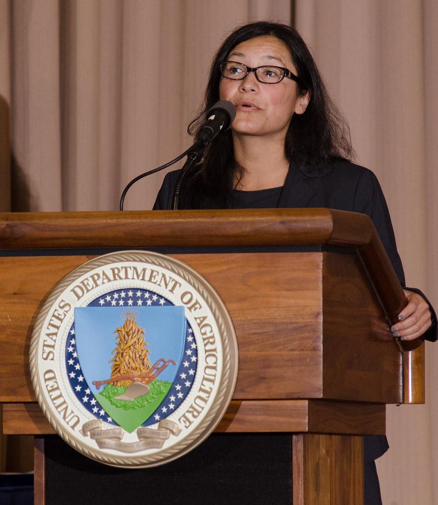 julia chavez rodriguez at a podium