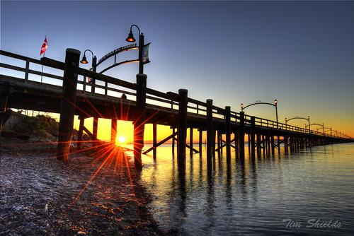 ocean beach water sunrise dock sunburst starburst whiterockpier dynamichdr timshields timshieldsvancouver timshieldsrcmp
