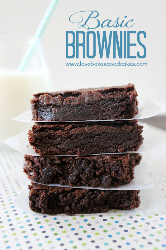 Basic Brownies stacked up with a glass of milk.