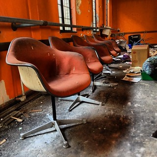 Herman Miller Fiberglass Chairs in an abandoned community center