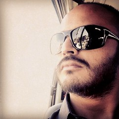 @MBAKhan - #Selfie #OnTheWay #Work #window #light #soft #afternoon #niceandwarm #prada #shades #sunglasses #beard