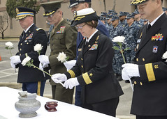 Rear Adm. Lisa Franchetti, commander of U.S. Naval Forces Korea, lays a flower during a remembrance service honoring sailors lost in the sinking of the ROKS Cheonan (PCC-772). (U.S. Navy/MC1 Joshua Bryce Bruns)