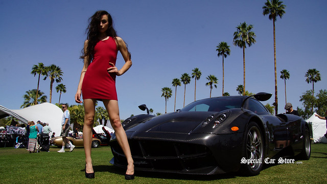 Model wearing red fitted dress by She She in front of Pagani Huayra