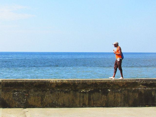 Candid Man walking along the Malecon Road