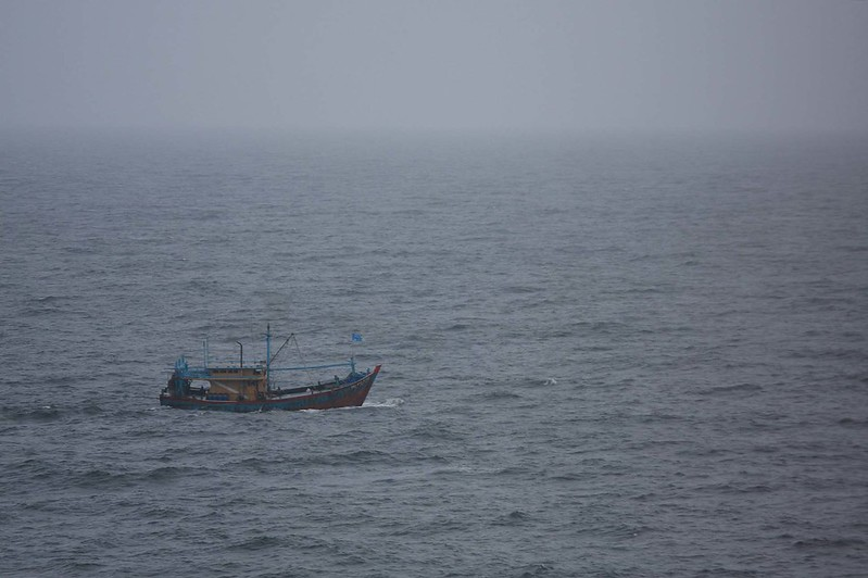 Fishing boat just before rain sweeps over it
