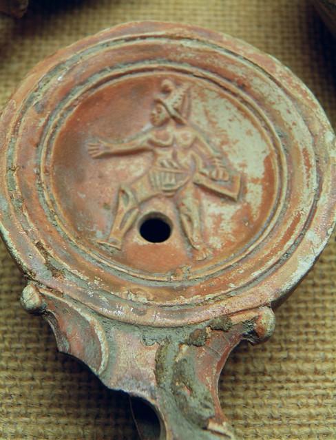 Terracotta oil lamp with gladiatoral scene, Musée gallo-romain de Fourvière, Lyon