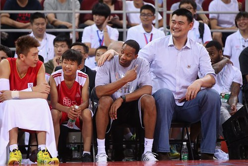 July 1st, 2013 - Yao Ming and Tracy McGrady watch the action as coaches in the Yao Foundation charity game in Beijing