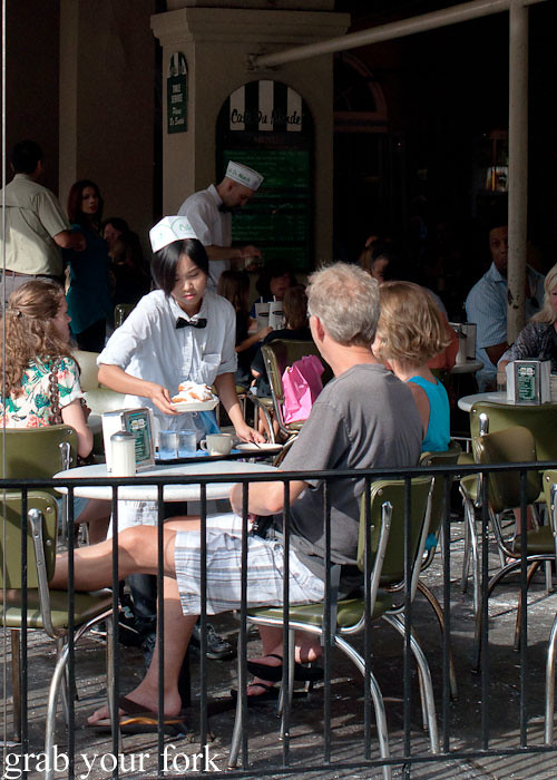 waiters table service at cafe du monde at the french market in new orleans louisiana