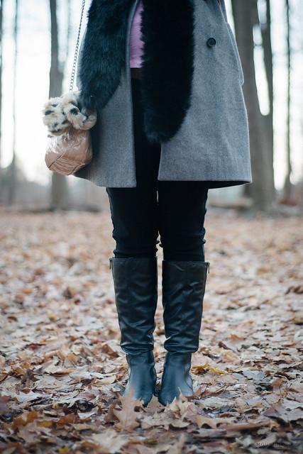 grey wool coat, black faux fur stole, black boots