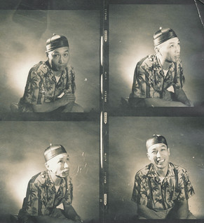 Chinese man doing faces in the photo booth