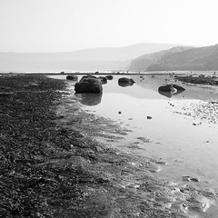 #robinhoodsbay#yorkshire#england#coast#beach#sea#rockpool#rocks#hills#cliffs#sky#b&w