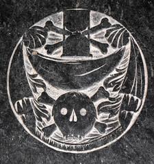 ledger stone: hour glass and crossed bones, winding sheet, skull and crossed bones