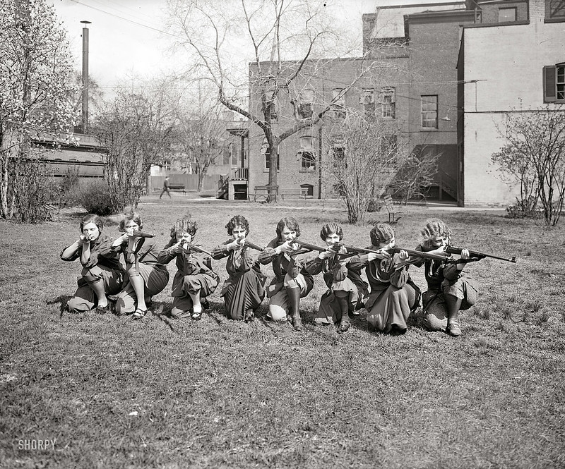 1925: Co-ed girls with rifles