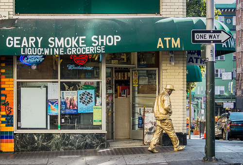 Gold Man Passing Geary Smoke Shop