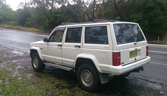 automobile(1.0), automotive exterior(1.0), sport utility vehicle(1.0), jeep cherokee (xj)(1.0), vehicle(1.0), compact sport utility vehicle(1.0), jeep(1.0), bumper(1.0), land vehicle(1.0),