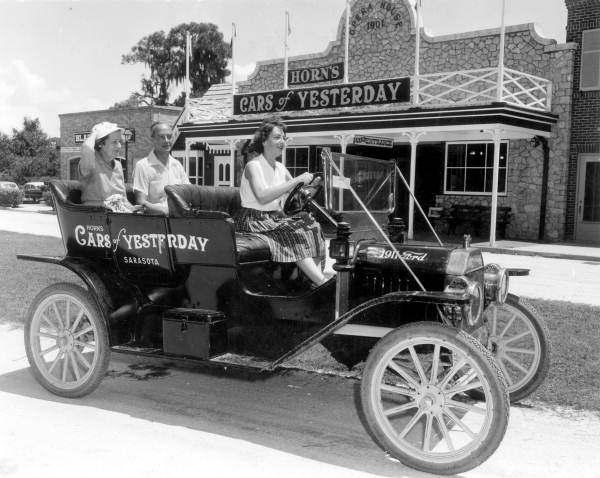 Visitors in front of Horn's Cars of Yesterday in Sarasota, Florida
