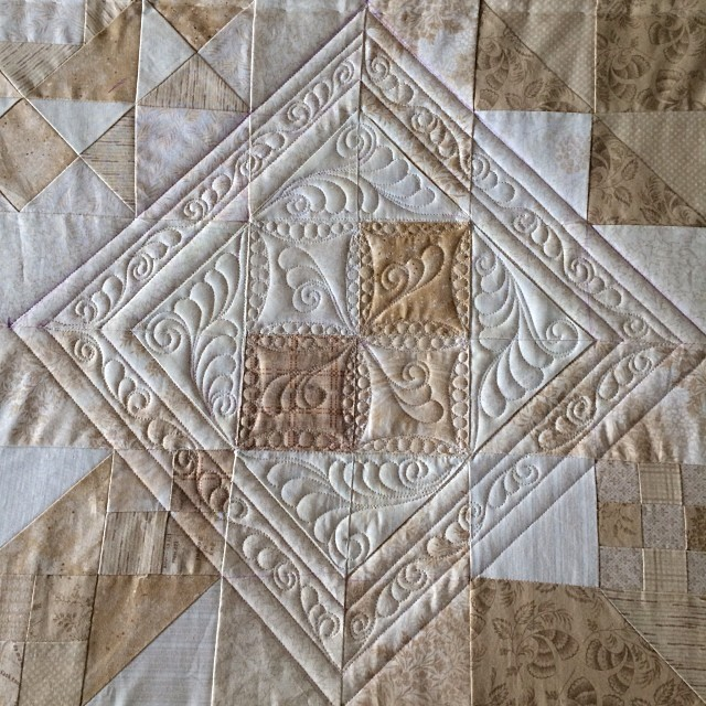 Another weather related day off from school, another day to quilt. On the frame today, a sampler. Trying to work outside the block....