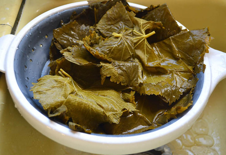 Grape leaves that come in a jar need to be rinsed well. Seperate each grape leaf under cool running water and drain well.