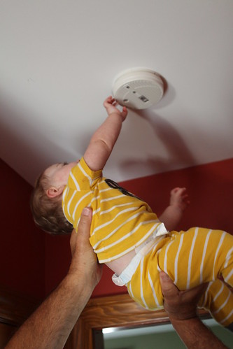 Grandpa Lifts Martin up to Smoke Detector