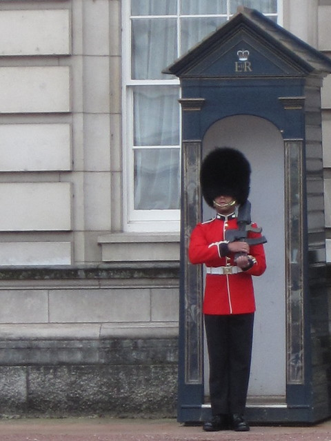 a beefeater guarding Buckingham Palace