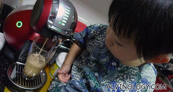 Asher watching the machine
