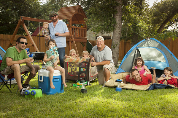 A bunch of dads and their kids camping on the show, looking normal and happy