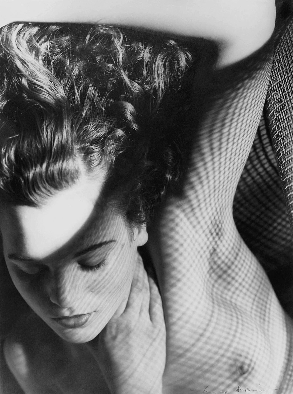 30 - Max Dupain, Jean in wire mesh, 1937