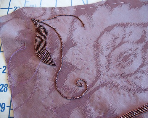 Lilacs lace transferring a beading pattern to fabric