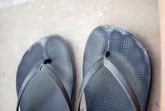 outdoor shoe(0.0), shoe(0.0), sandal(0.0), limb(0.0), leg(0.0), human body(0.0), blue(0.0), pattern(1.0), footwear(1.0), flip-flops(1.0),