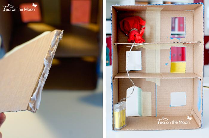 Casa con caja de cartón pisos