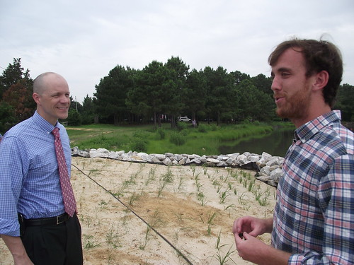 Restoration effort:  Acting USDA Under Secretary Doug O'Brien with Patrick Hudson, Operations Manager, True Chesapeake Oyster Company.  In the background is some of the shoreline restoration that USDA funding helped support. USDA photo.