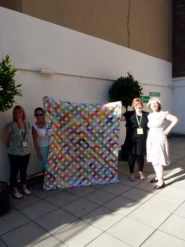Some of my Fellow Bee a Brit Stingy with the quilt they helped me make