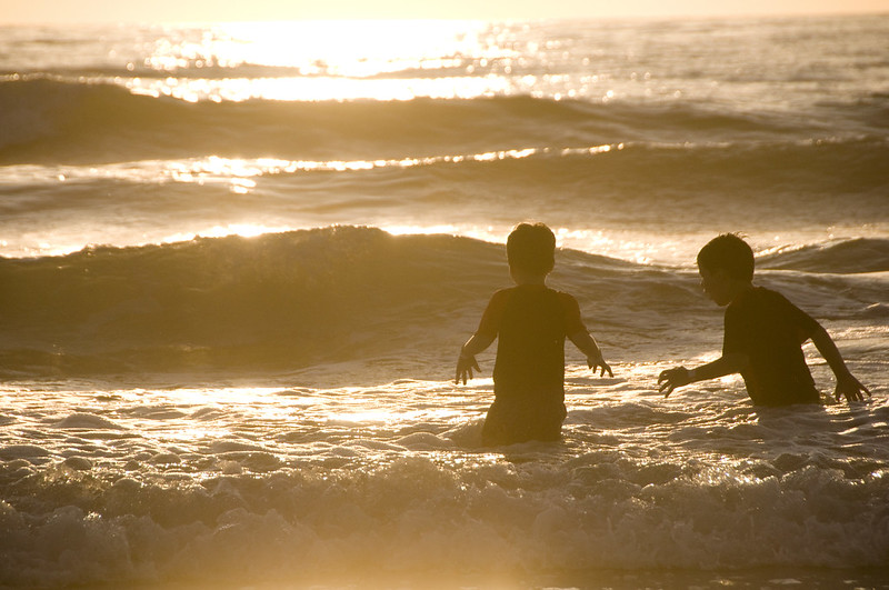 children in the surf