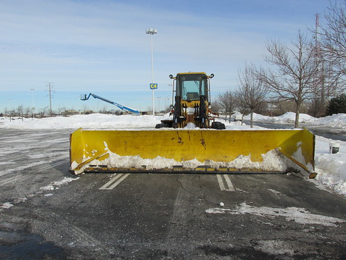 An extra wide snowplow attatchment. That much needed weapon in the seasonal war on parking lot snow removal.  Schaumburg Illinois.  Wednsday, January 8th, 2014. by Eddie from Chicago