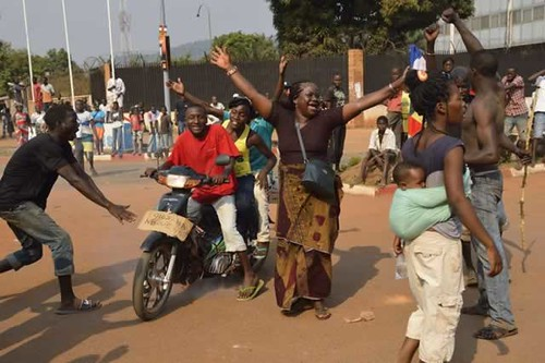 Central African Republic residents celebrating on January 10, 2014 after the forced resignation of Michel Djotodia. France is attempting to control its former colony. by Pan-African News Wire File Photos