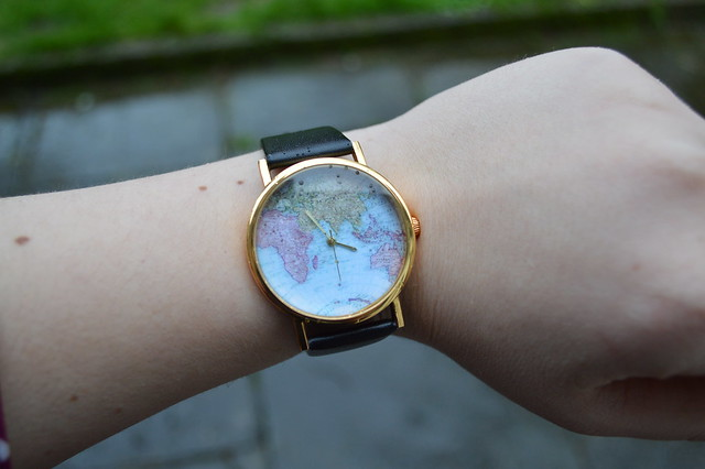 a picture of a map dial watch