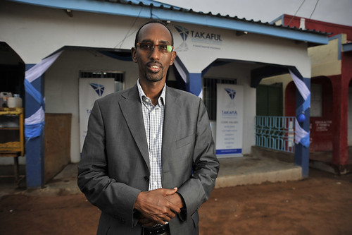 Takaful CEO Hassan Bashir in front of the new Takaful Insurance of Africa branch in Wajir