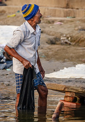 Clothes washer on the Ganges in Varanasi, India