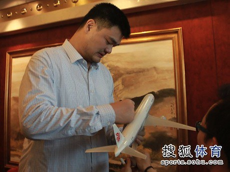 July 11th, 2013 - Yao Ming signs a model Air China plane before departing on its inaugural flight from Beijing to Houston