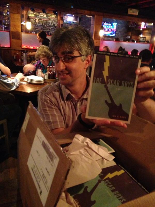 Len holding up book.
