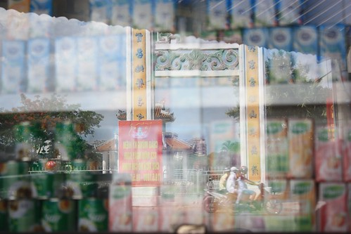 Reflections from a food stall… Vietnamese life. Motorbikes. Beautiful Architecture.