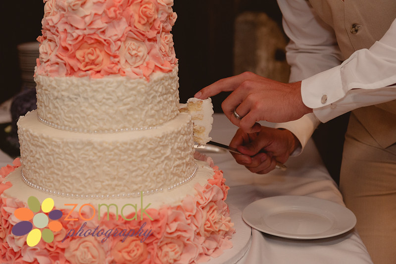 Beautiful detail of pink and white cake at wedding reception