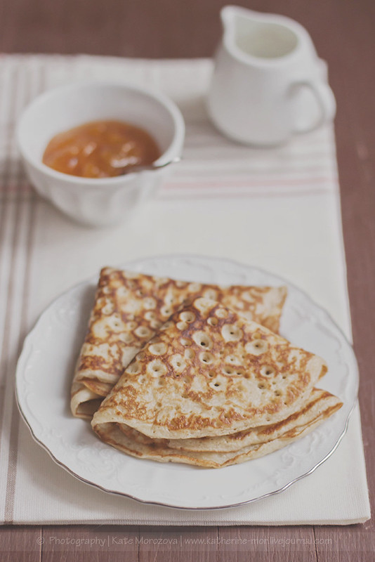 Breakfast. Pancakes with apricot confiture