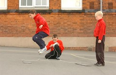 Kids jumping from one timing mat to another