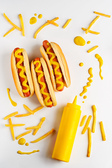 Mustard bottle and hot dogs