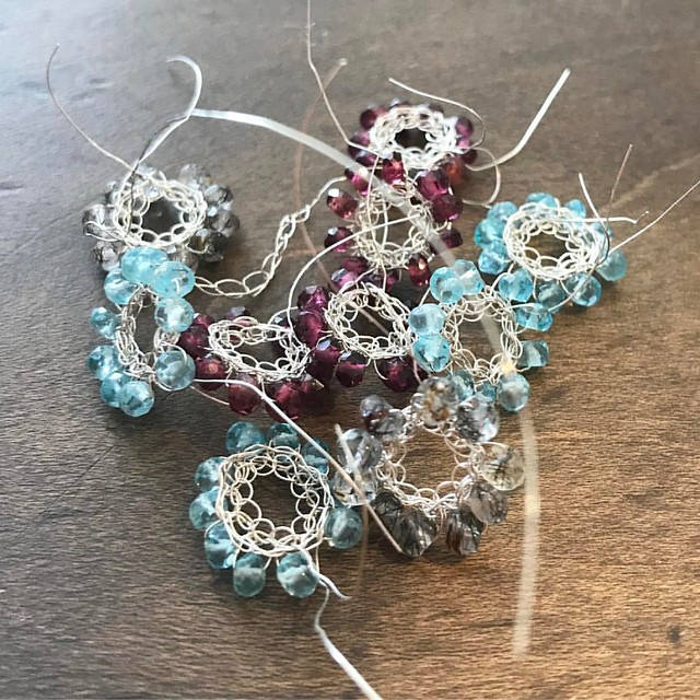 Pretty little crochet wheels... (wheels? Everything looks like wheels to me nowadays 🤔😃🌞) Working today  #izabelamotyl  #buckinghamshire #crochet #crochetingjewellery #tiny #semiprecious #jewellerymaker #jewelleryaddict