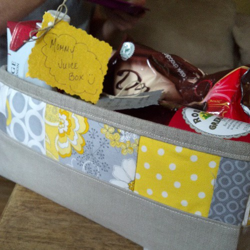 All set. Fabric gift box full of treats and some 'because it's funny' items. Just what every mom-to-be needs :)