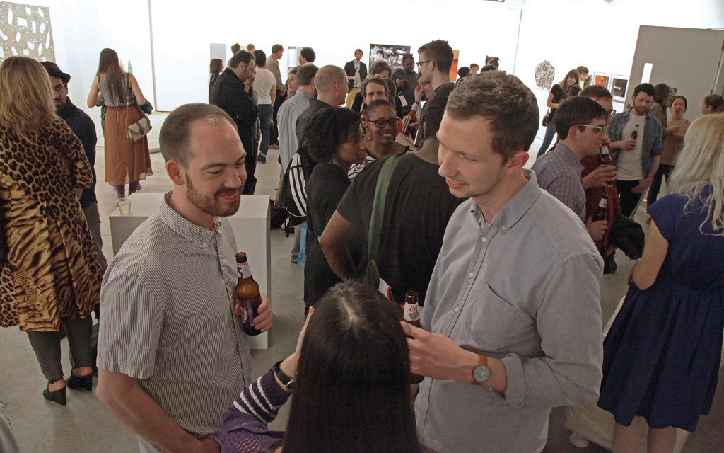 Brian Dunn (M.F.A. '13), left, and Jerry Birchfield (M.F.A. '14), with guest, at the opening reception.