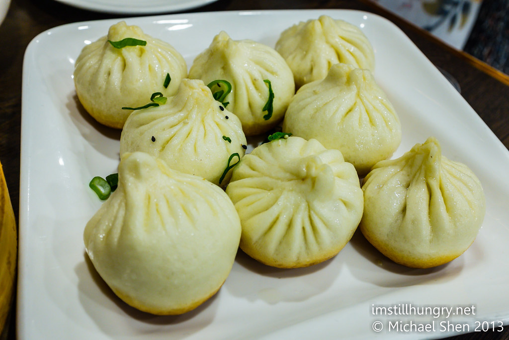 Pan fried pork buns w/sesame Taste of Shanghai