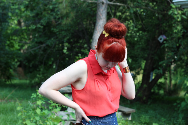 red hair bun with an orange shirt